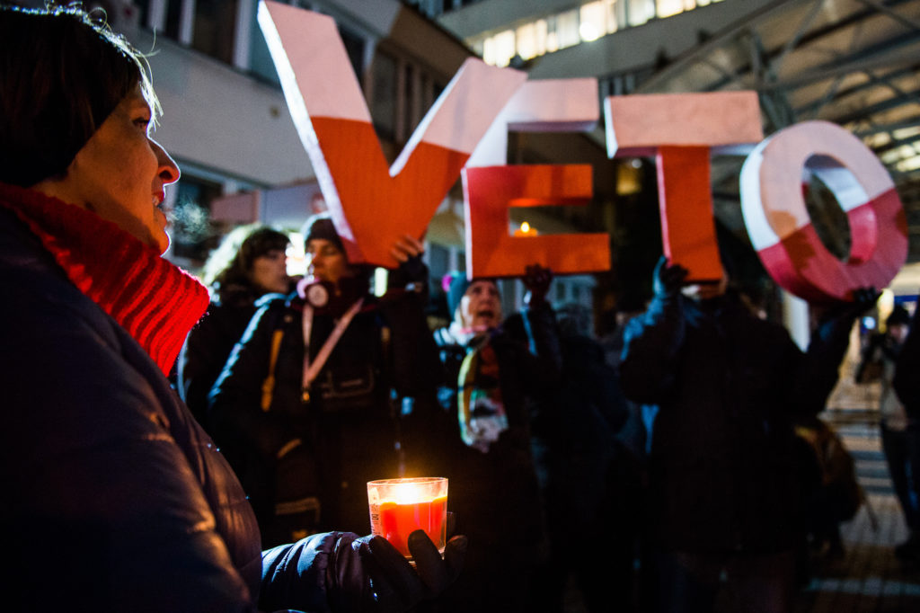 Protestors hold the word VETO during a protest against the reform of acts on the Supreme Courts  in Krakow, Poland on December 14, 2017. The Supreme Court law is wonder work in the Senate today.